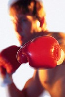 Selective focus on glove of boxer