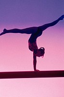 Silhouette of gymnast on balance beam