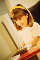 Girl using home computer