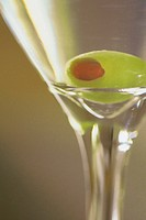 Martini glass with green olive
