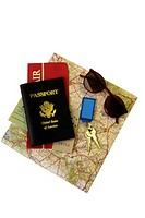 Passport, tickets, map, keys and sunglasses