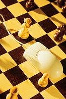 Computer mouse on chess board, on-line chess