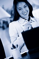 Businesswoman at desk (portrait)
