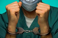 Surgeon in handcuffs