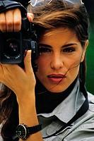 Woman aiming camera