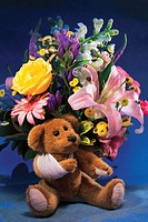 Bouquet of flowers with teddy bear
