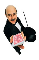 Magician holding out a deck of playing cards, shot aerial shots, portrait
