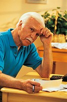 Mature man working on personal finances