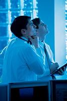 Businessmen in office looking up