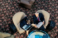Businesswoman with laptop and man meeting, from above