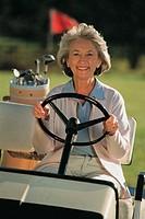 Woman driving golf cart