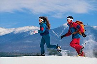 Snow shoeing with the Presidential Mt Range in the background. White Mountain National Forest, Bretton Woods, N.H