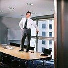 Businessman with golf club in office