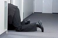 Businessman crawling on floor