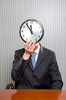 Businessman with a clock face