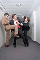 Businessmen fighting in corridor