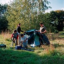 Family erecting a tent