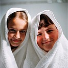 Children wearing towels on head