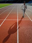 Female runner on race track
