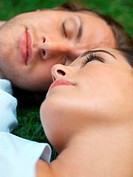 Young couple sleeping in field (thumbnail)