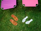 Sandals and lounge chairs in garden