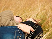 Couple resting in field