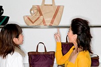 Women shopping for handbags (thumbnail)