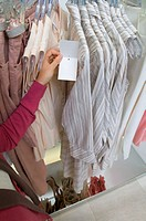 Young woman in clothes store (thumbnail)