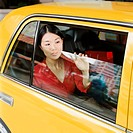 Woman looking out of taxicab window