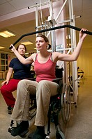 Disabled woman weight lifting
