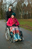 Disabled woman and partner in park
