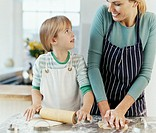 Mother and Daughter Preparing Dough in a Kitchen