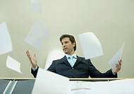 Angry Businessman Throwing Paperwork into the Air