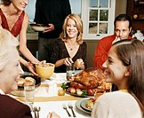Family Enjoying a Thanksgiving Meal Together