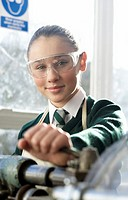 Portrait of a Schoolgirl Operating a Lathe in a Classroom