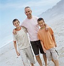 Portrait of a Father Standing With His Two Sons on the Beach