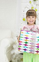 Portrait of a Young Girl Holding a Wrapped Christmas Present