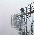 Couple Walking on Pier in Fog Lake Winnipeg Ponemah Manitoba