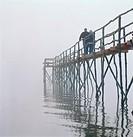 Couple Walking on Pier in Fog Lake Winnipeg Ponemah Manitoba
