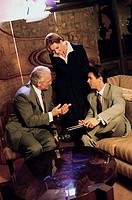 Three business executives talking