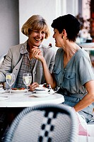 Two women sitting together in a cafe