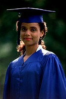 Portrait of a young woman wearing a graduation outfit