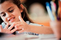 Close-up of a girl counting on her fingers