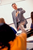 Male teacher standing in front of a classroom