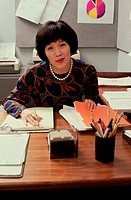 Portrait of a businesswoman seated behind a desk in an office