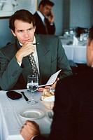 Businessmen discussing in a restaurant