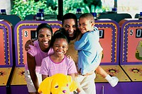 Couple in an amusement park with their son and daughter