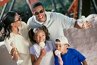 Parents and their two children eating ice cream cones