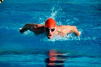 Young man swimming the butterfly stroke (thumbnail)