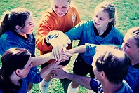 High angle view of a girl's soccer team in a huddle